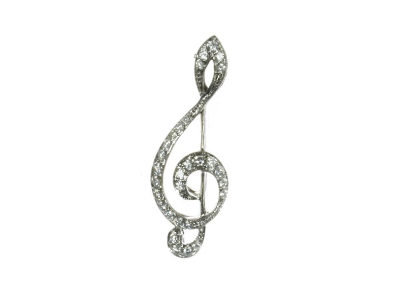 Diamond treble clef brooch